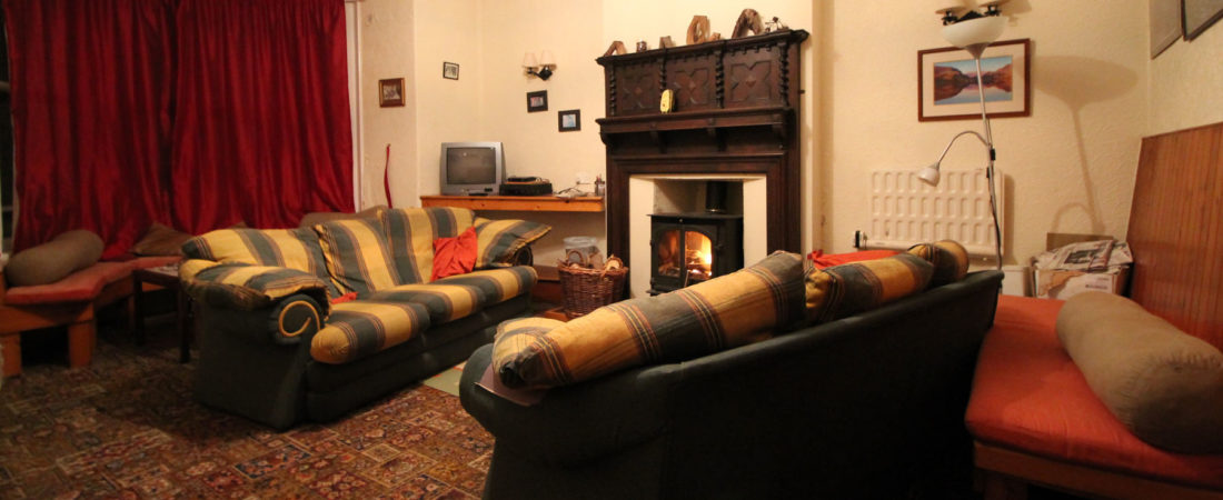 group accommodation in snowdonia, lounge with log burner